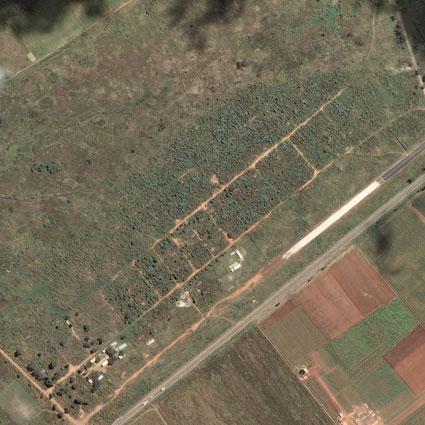 Porta Farm, Sudan, before and after attacks in 2006.